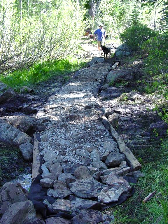 Raised wetland rock path under construction nearby Graeagle Creek.