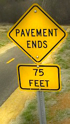 Pavement ends before reaching New York Creek